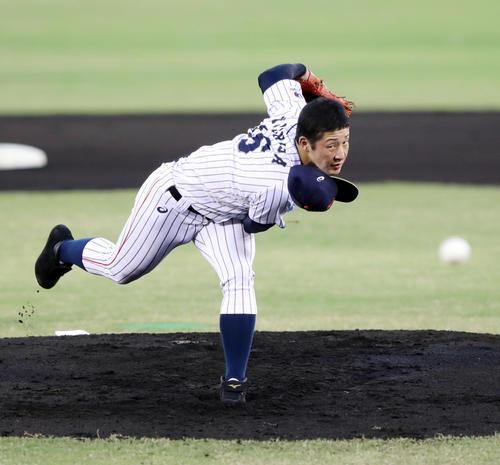 韓国対日本 日本先発の吉田は帽子を飛ばしながら力投する(撮影・垰建太)