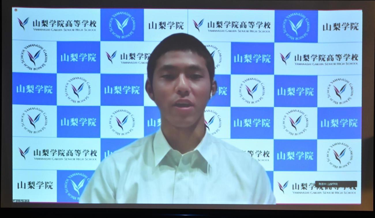 対戦相手が決まり、抱負を述べる山梨学院の功刀史也主将(代表撮影)