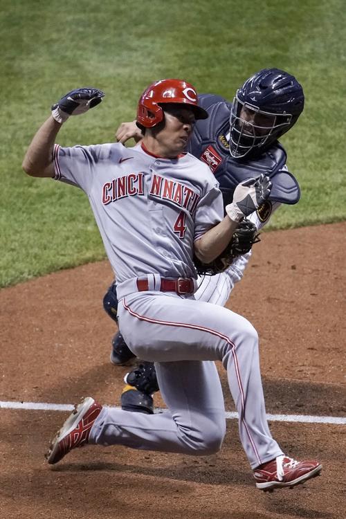 7回、ボットの外野フライで秋山は三塁からタッチアップしたがタッチアウト(AP)