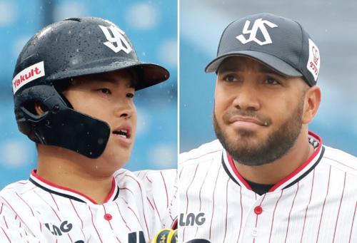 村上宗隆(左)とスアレス