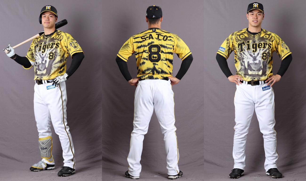 2021年の「ウル虎イエローユニフォーム」を着る佐藤輝明(球団提供)