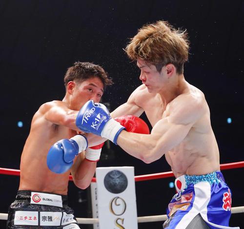 第2R、金子(右)に右ストレートを見舞う林(撮影・河田真司)