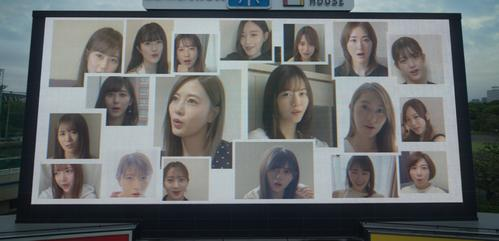 "A scene from Nogizaka46's new song ""Neighbors of the World"" music video. The members singing are reflected on the monitor at Jingu Stadium [1st gen]"