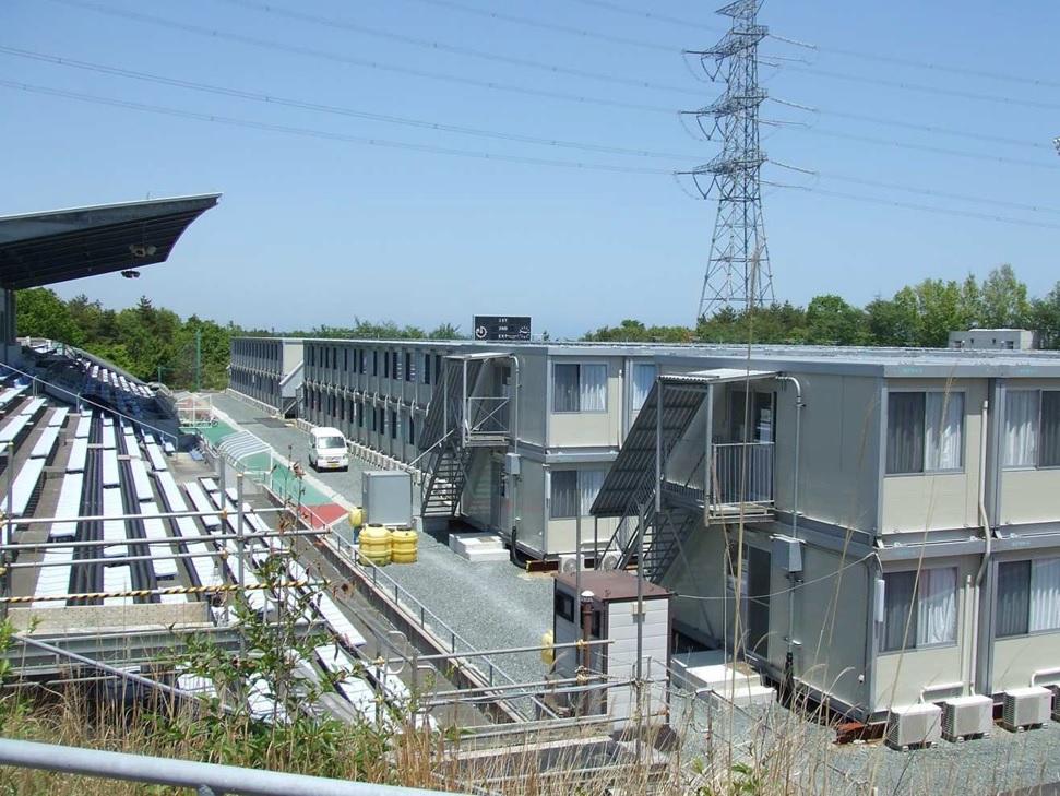 東日本大震災発生後に福島第1原発事故の対応拠点となり、住宅が作られたJヴィレッジスタジアム(Jヴィレッジ提供)