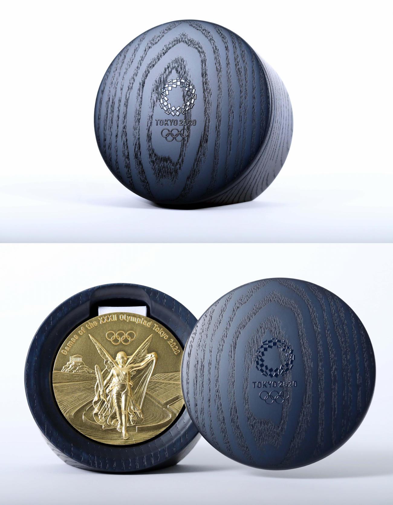 東京五輪・パラリンピックのメダルケース。ふたをずらすと下のようにメダルが現れる(ⓒTokyo2020)