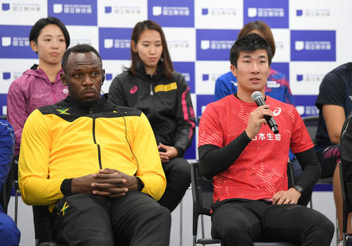 """Kiryu participates in the new national stadium opening event @ Sports Part """"ONE Race"""" and answers questions at a conference. Mr. Bolt on the left [photo by Ryo Kato]"""