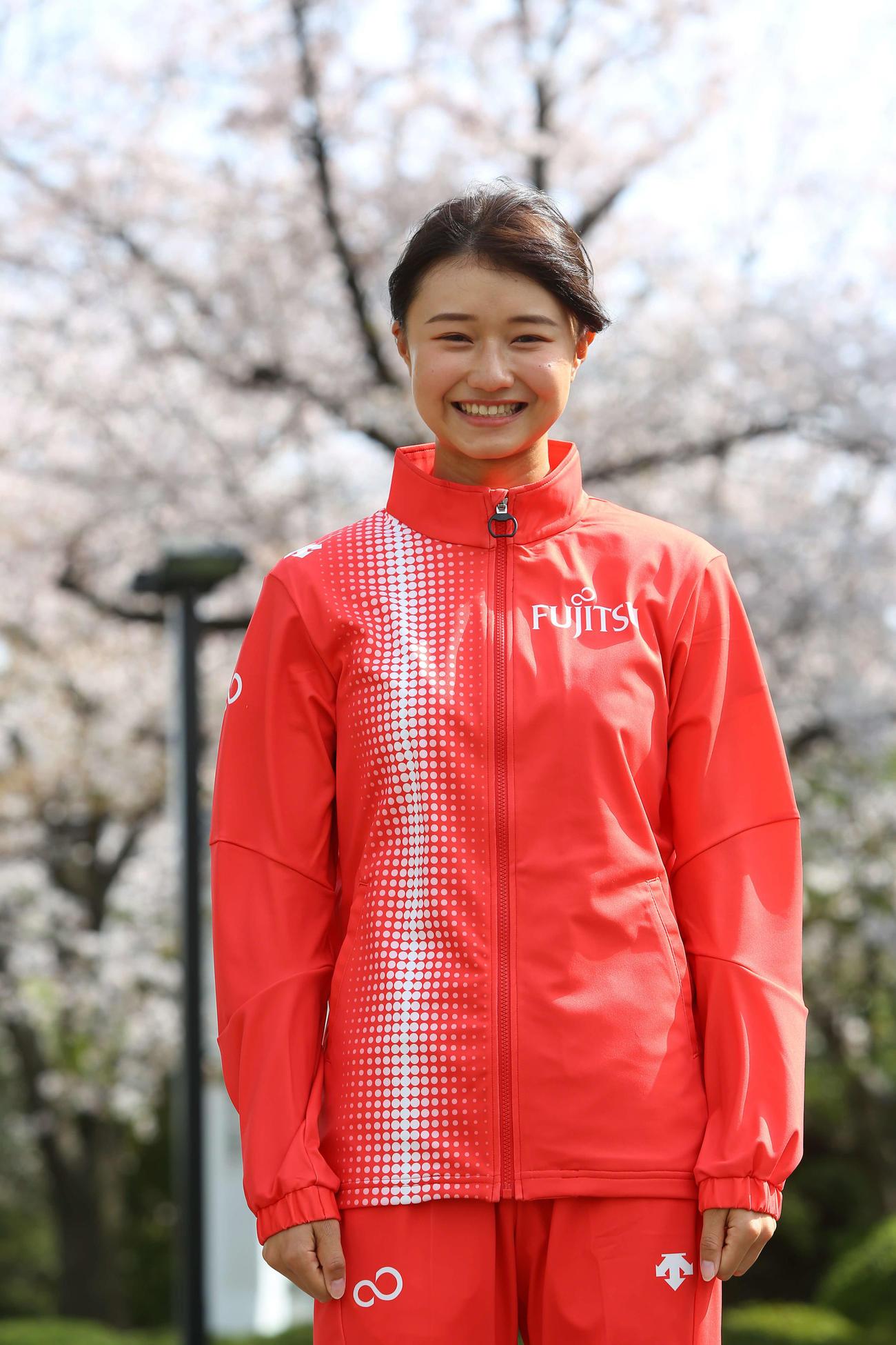 富士通のジャージを着て、笑顔の田中