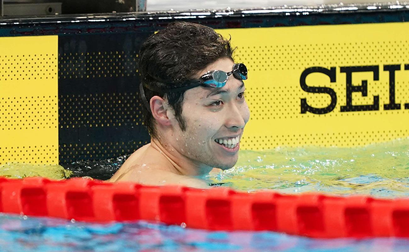男子200メートル個人メドレーで優勝し笑顔の萩野(撮影・鈴木みどり)